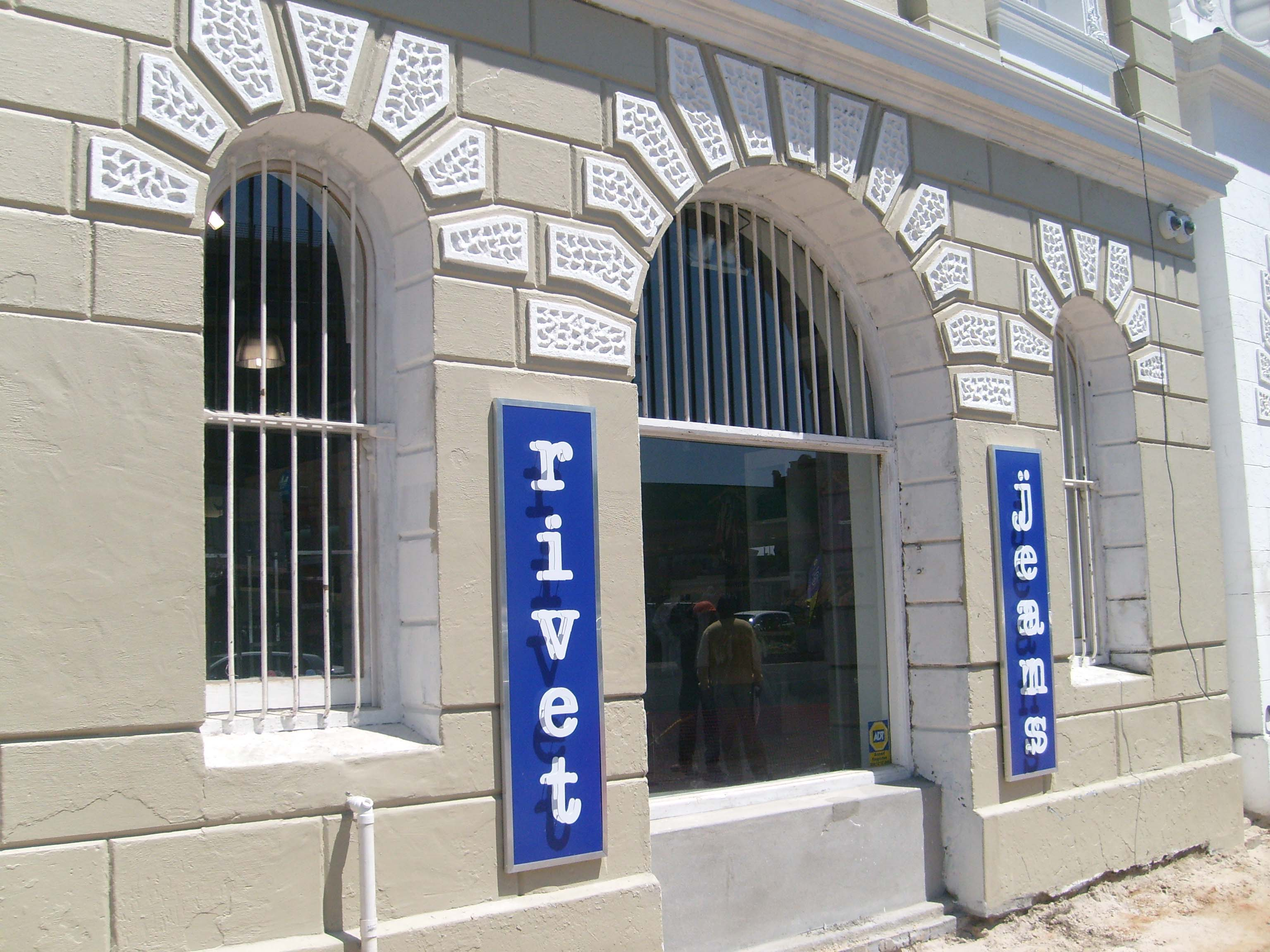 Signs for your shop in cape town rivet jeans cut out letters mounted to chromadek board with frame spiritdancerdesigns Gallery