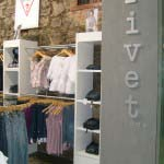 Rivet - Cut out brushed aluminium lettering raised on concealed pins