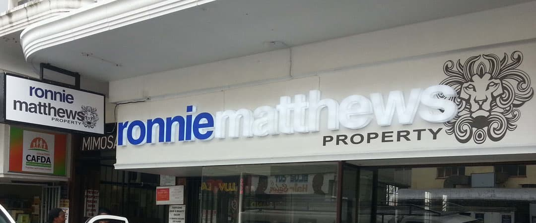 ronnie matthews property shop front sign